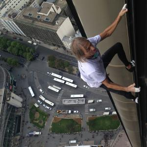 Alain Robert climbs Montparnasse tower spiderman escalade la tour Montparnasse